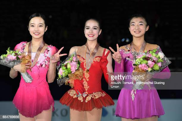 Marin Honda of Japan Alina Zagitova of Russia and Kaori Sakamoto of Japan pose with their medals during the 4th day of the World Junior Figure...