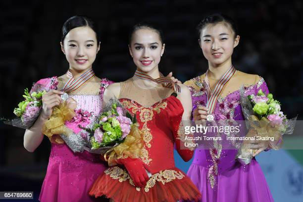 Marin Honda of Japan Alina Zagitova of Russia and Kaori Sakamoto of Japan pose on the podium in the medal ceremony for the Junior Ladies Free Skating...