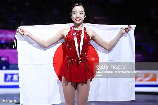 Marin Honda of Japan and bronze medal poses during the Junior Ladies medals ceremony during day three of the ISU Grand Prix of Figure Skating Final...
