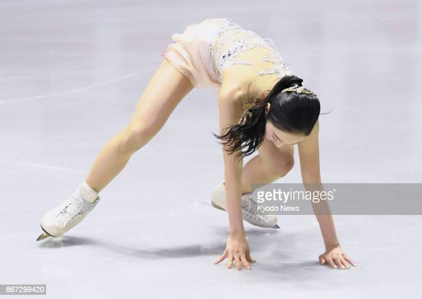 Marin Honda of Japan falls on a jump during the women's short program at Skate Canada International in Regina Canada on Oct 27 2017 Honda finished...