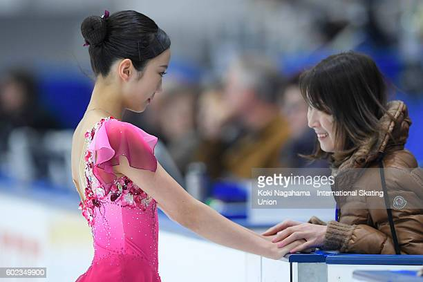Marin Honda of Japan has a moment with her coach prior to the junior women's free program during the ISU Junior Grand Prix of Figure Skating Yokohama...