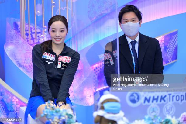 Marin Honda of Japan pose for photographs with her coach in the kiss & cry after the Ladies Free Skating during day 2 of the ISU Grand Prix of Figure...