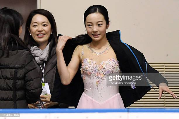 Marin Honda reacts after competing in the Women's Singles Short Program during day two of the 85th All Japan Figure Skating Junior Championships at...