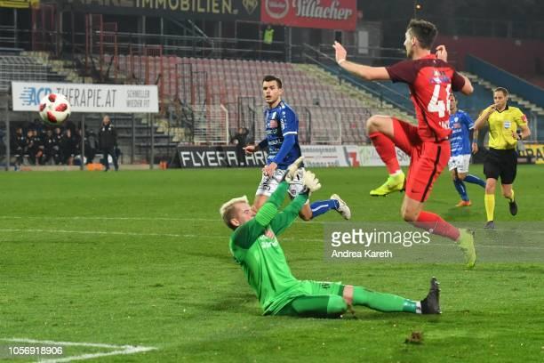 Marin Jakolis of Admira shoots at the goal over Goalkeeper Rene Swete of Hartberg during the tipico Bundesliga match between FC Admira and TSV...