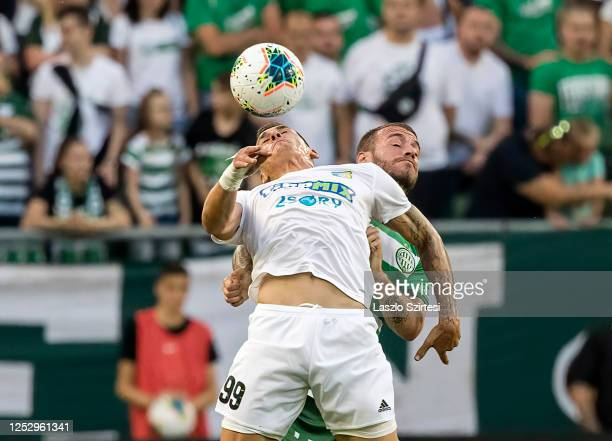Marin Jurina of Mezokovesd Zsory FC battles for the ball in the air with Miha Blazic of Ferencvarosi TC during the Hungarian OTP Bank Liga match...