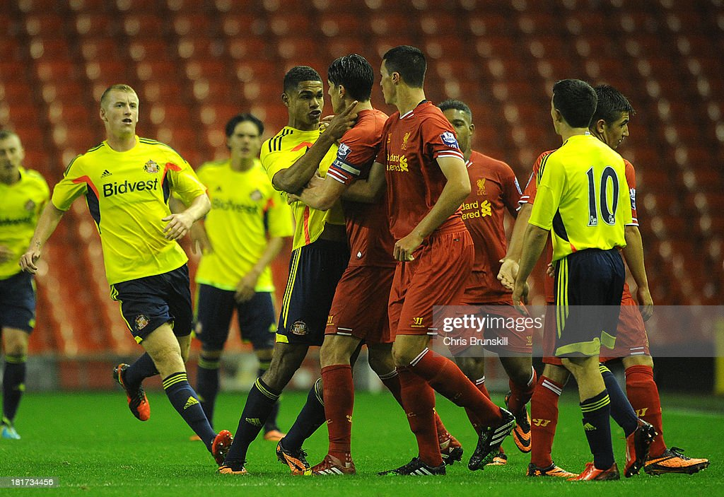 Marin Kelly of Liverpool U21 clashes with Mikael Mandron of Sunderland U21 during the Barclays U21s Premier League match between Liverpool U21 and Sunderland U21 at Anfield on September 17, 2013 in Liverpool, England.
