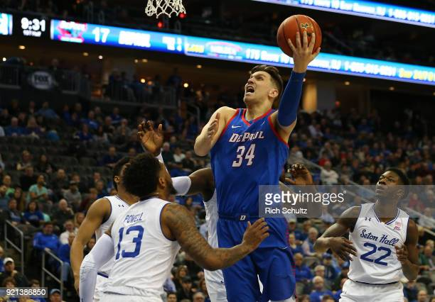 Marin Maric of the DePaul Blue Demons attempts a shot as Myles Powell Desi Rodriguez Angel Delgado and Myles Cale of the Seton Hall Pirates defend...