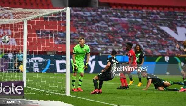 Marin Pongracic of Wolfsburg scores his team's first goal during the Bundesliga match between Bayer 04 Leverkusen and VfL Wolfsburg at BayArena on...