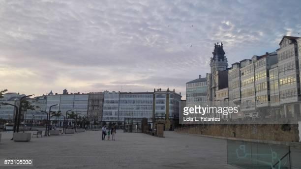 Marina, A Coruña cityscape at sunset