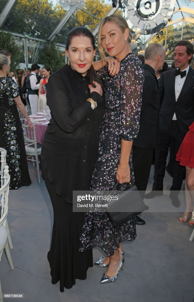 Marina Abramovic (L) and Maria Sharapova attend the Argento Ball for the Elton John AIDS Foundation in association with BVLGARI & Bob and Tamar Manoukian on June 27, 2018 in Windsor, England.