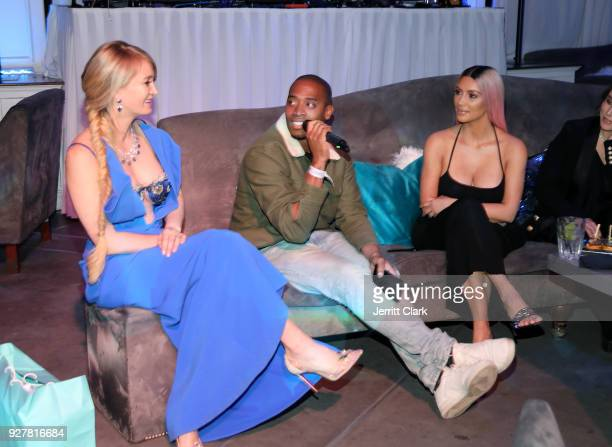 Marina Acton Ray Romulus and Kim Kardashian attend the release of Marina Acton's new single Fantasize at Boulevard3 on March 5 2018 in Hollywood...