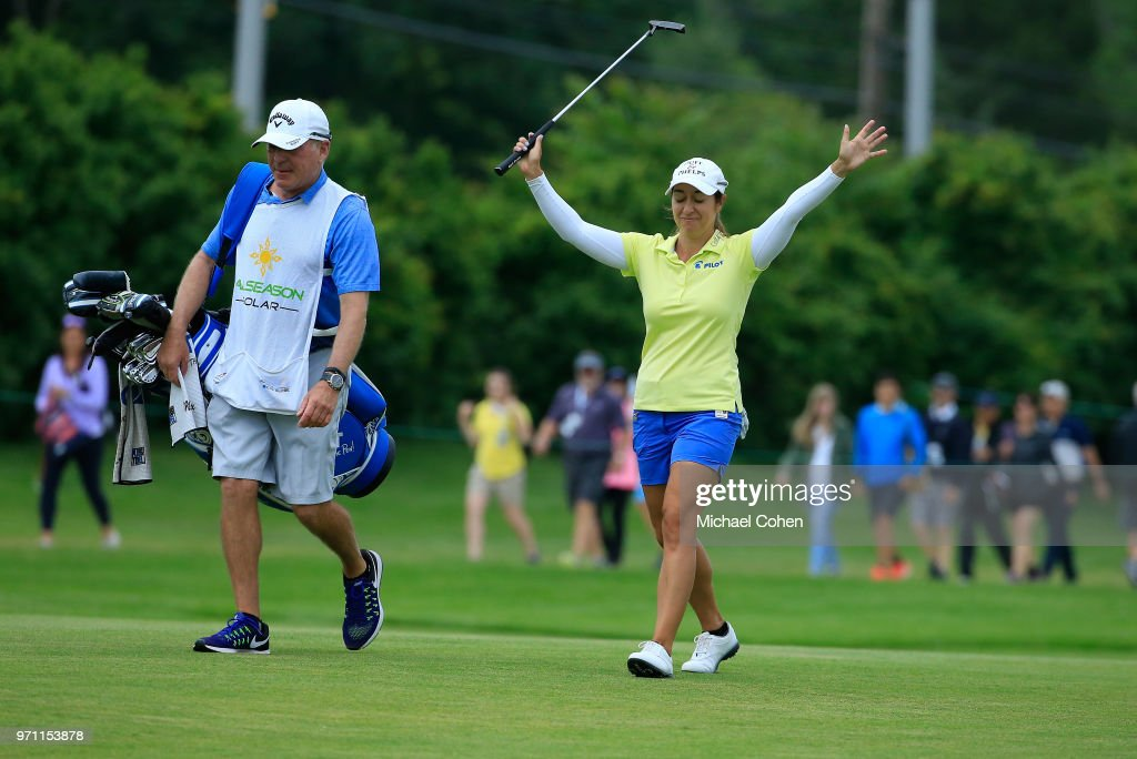 Marina Alex acknowledges the gallery as she is introduced at the 18th green during the third and final round of the ShopRite LPGA Classic Presented by Acer on the Bay Course at Stockton Seaview Hotel and Golf Club on June 10, 2018 in Galloway, New Jersey.
