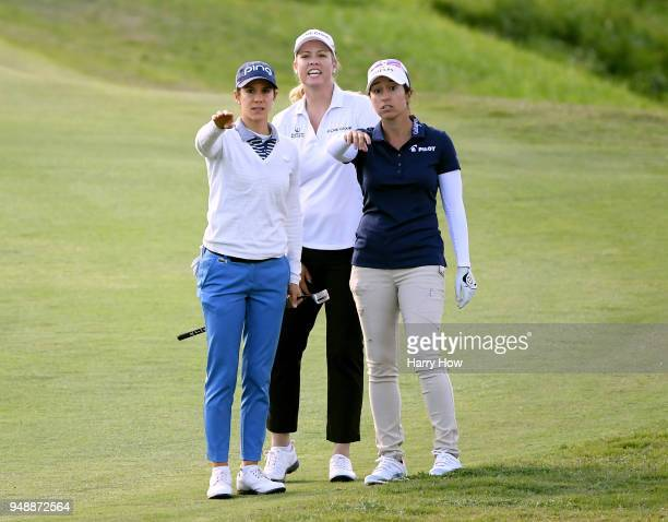 Marina Alex get help finding the ball from Brittany Lincicome and Azahara Munoz of Spain near the green of the 18th hole during round one of the...