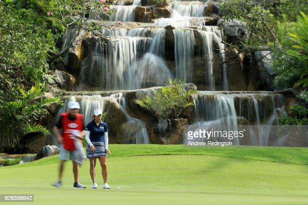 Marina Alex of the United States and her caddie line up a putt on the third green during round three of the HSBC Women's World Championship at...