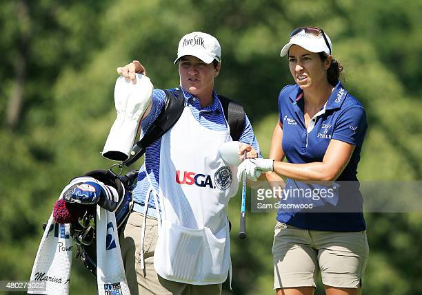 Marina Alex of the United States lines up her tee shot on the ninth hole with her caddie Meaghan Francella during the second round of the US Women's...
