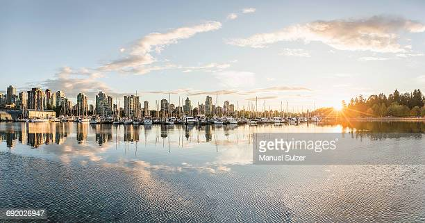 marina and city skyline at sunset, vancouver, canada - vancouver canada stock pictures, royalty-free photos & images