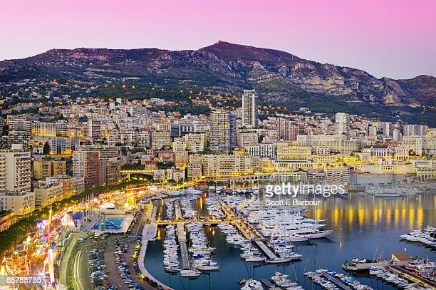 marina and cityscape of monaco at dusk - monte carlo stock-fotos und bilder