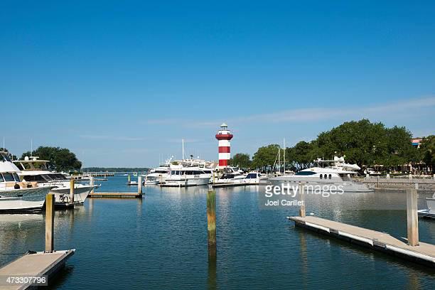marina and lighthouse on hilton head island, south carolina - hilton head stock pictures, royalty-free photos & images