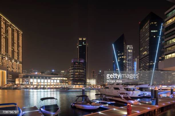 marina and skyscrapers in dubai at night, united arab emirates - image stock pictures, royalty-free photos & images