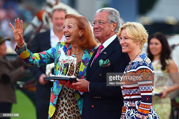 Marina and Toni Meggle pose with Nadine Capellmann after being awarded with the Silver Horse during the Opening Ceremony of the FEI European...
