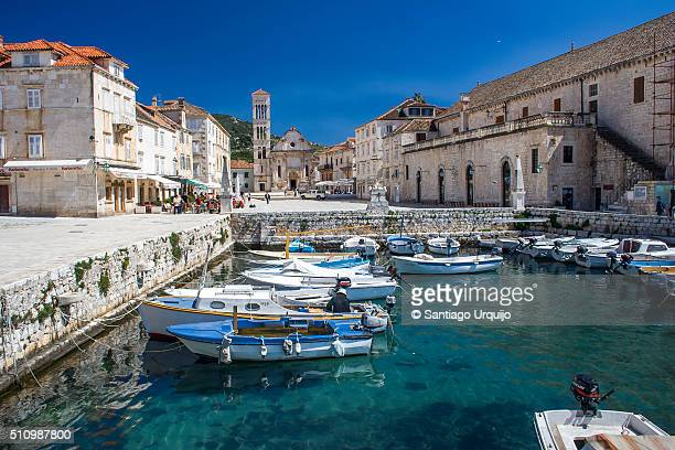 marina and town square of stari grad - hvar stock photos and pictures