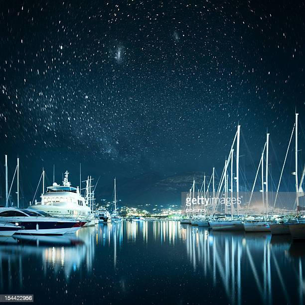 marina at night - yacht stock pictures, royalty-free photos & images