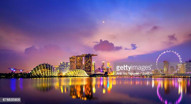 marina bay at dusk - singapore flyer stock photos and pictures