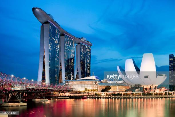 marina bay sands in singapore at sunset - nemo museum stock pictures, royalty-free photos & images