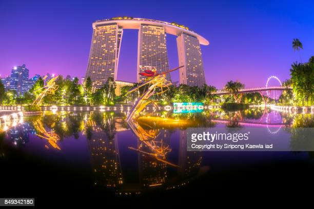 Marina Bay Sands with water reflection in twilight time.