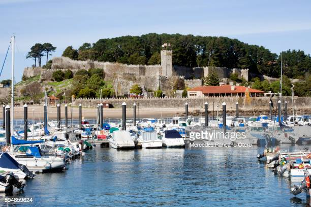 marina, beach and stone walls in bayona (galicia, spain) - pontevedra province stock photos and pictures