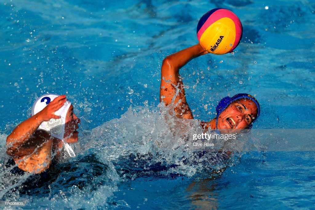 Marina Canetti of Brazil takes a shot under pressure from Dora Antal of Hungary during the Women's Water Polo first preliminary round match between Hungary and Brazil during Day Two of the 15th FINA World Championships at Piscines Bernat Picornell on July 21, 2013 in Barcelona, Spain.