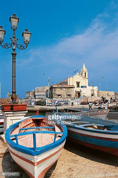 Marina Corta square with fishing boats in the foreground Lipari island Aeolian islands Sicily Italy