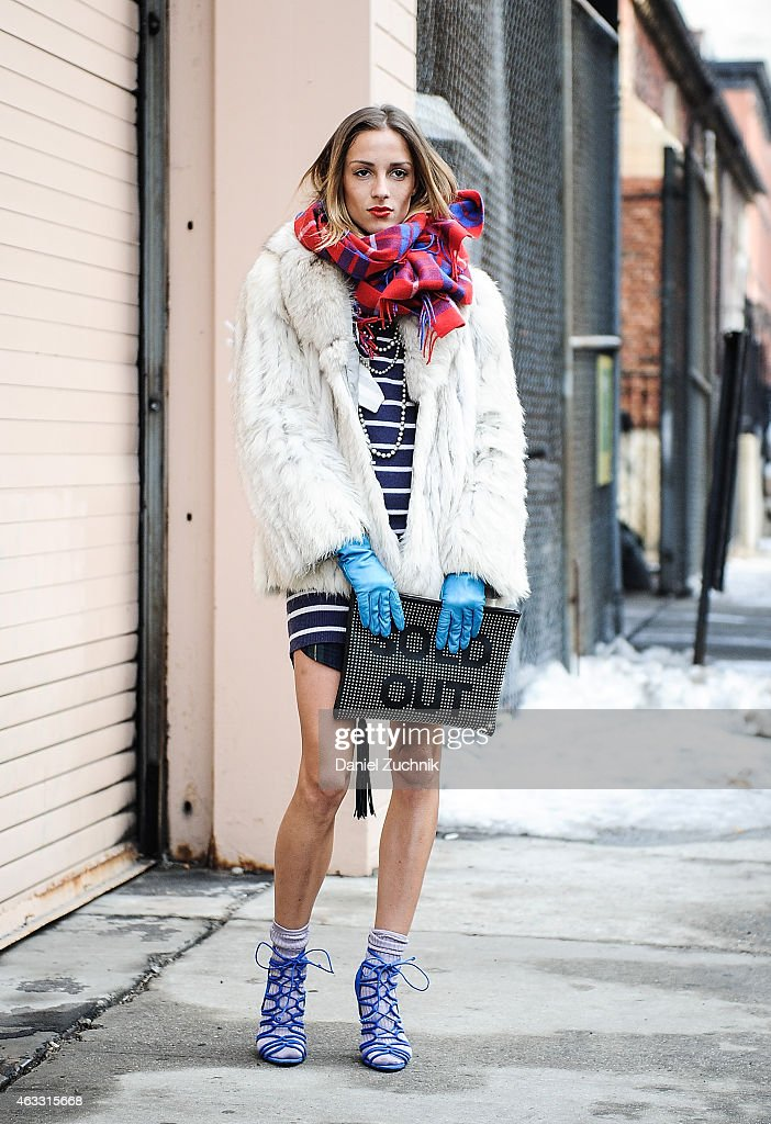 Marina Dobreva is seen outside the Honor show wearing a J. Crew dress, vintage fur, Zara heels and a Sold Out clutch on February 12, 2015 in New York City.
