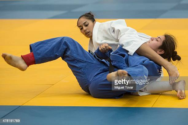 Marina Dos Santos of Brazil right competes with Barbara Comen of Chile in judo women's 63 kg during day six of the X South American Games Santiago...