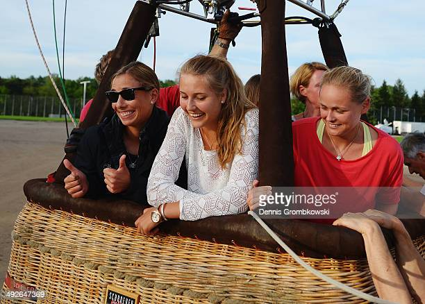 Marina Erakovic of New Zealand AnnaLena Groenefeld of Germany and Antonia Lottner of Germany take a ride in a hotair balloon during Day 5 of the...