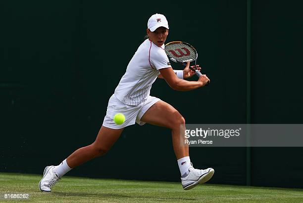 Marina Erakovic of New Zealand plays a backhand during the women's singles round one match against Michaella Krajicek of Netherlands on day two of...