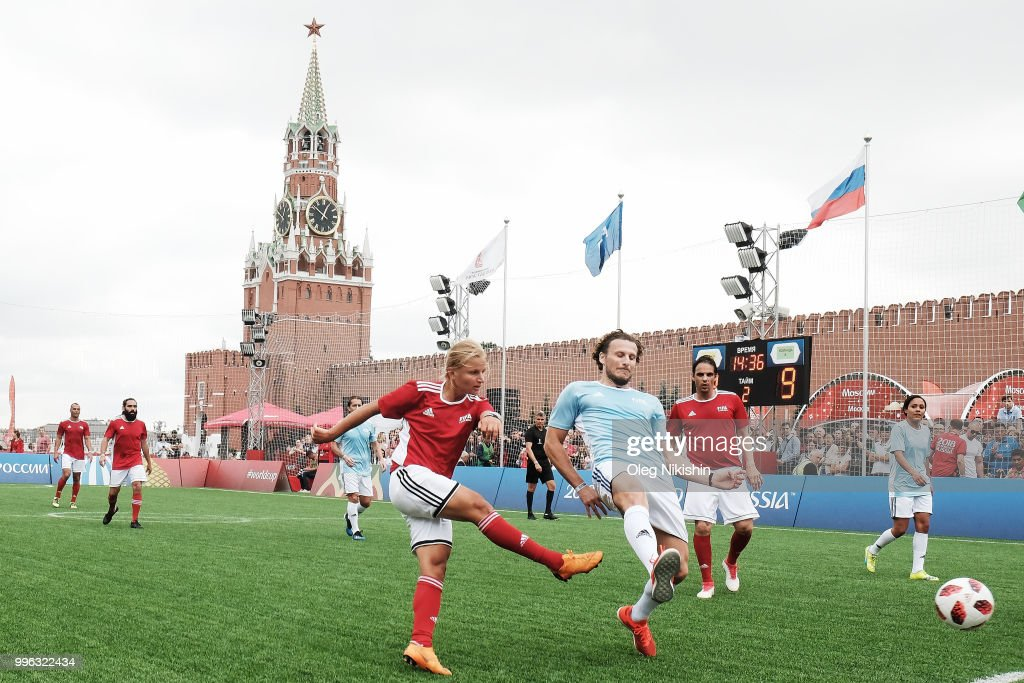 Marina Fedorova (L) and Diego Forlan compete during the Legends Football Match in 'The park of Soccer and rest' at Red Square on July 11, 2018 in Moscow, Russia.
