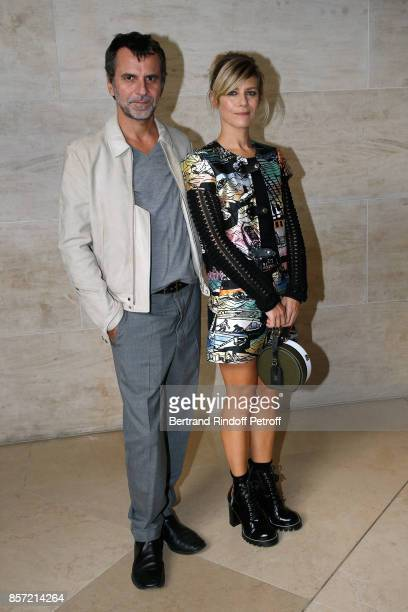 Marina Fois and her husband Eric Lartigau attend the Louis Vuitton show as part of the Paris Fashion Week Womenswear Spring/Summer 2018 on October 3...