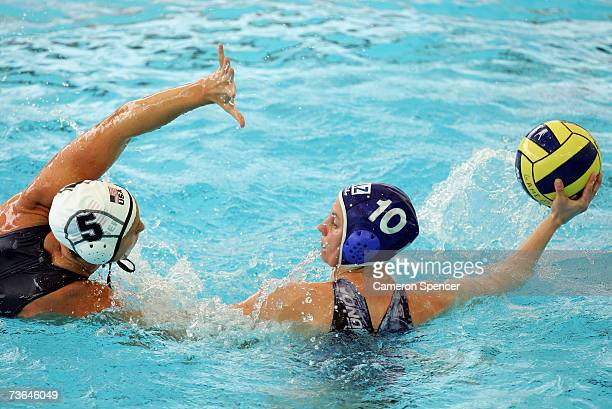 Marina Gritsenko of Kazakhstan is defended by Lauren Wenger of the United States in the Women's Preliminary Round Group C Water Polo match between...