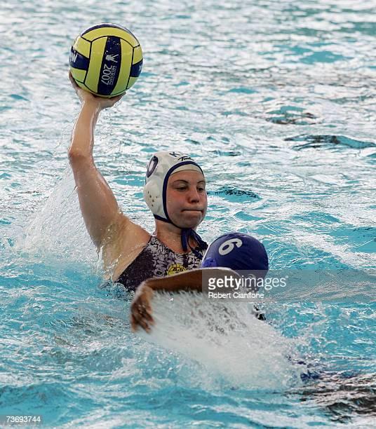 Marina Gritsenko of Kazakhstan makes a pass under pressure from Yamira Caballero of Cuba during the Women's Final Round Water Polo match between...