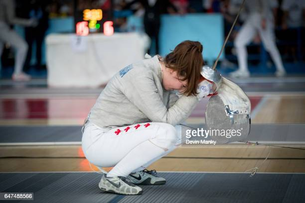 Marina Guintchitskaia reacts after losing an elimination match during Cadet Women's Sabre competition at the Cadet and Junior PanAmerican Fencing...