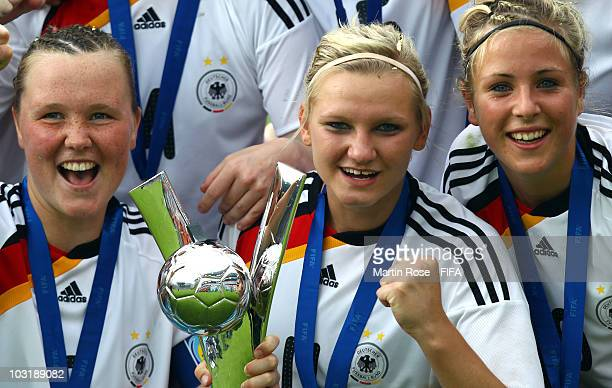 Marina Hegering Alexandra Popp and Svenja Huth of Germany celebrate after winning the 2010 FIFA Women's World Cup Final match between Germany and...