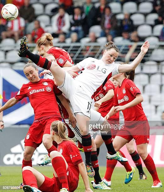 Marina Hegering of Bayer Leverkusen is thrown off balance as she competes for a corner kick during the Women's Bundesliga match at Gruenwalder Street...