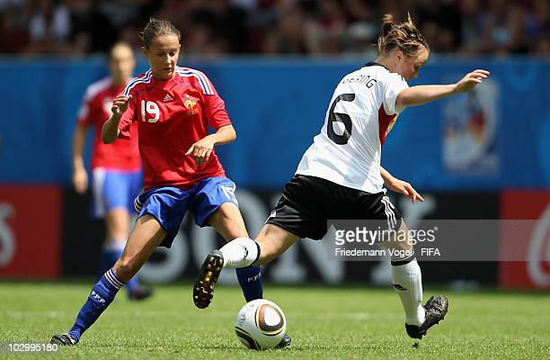 Marina Hegering of Germany and Amelie Barbetta of France battle for the ball during the FIFA U20 Women's World Cup Group A match between France and...