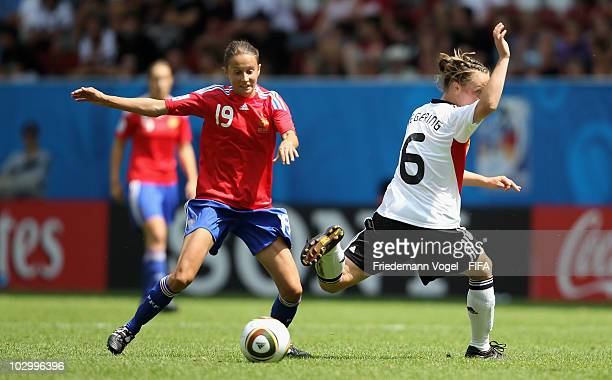 Marina Hegering of Germany battles for the ball with Amelie Barbetta of France during the FIFA U20 Women's World Cup Group A match between France and...