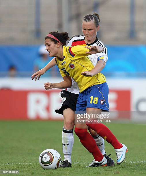 Marina Hegering of Germany in action with Ana Maria Montoya of Colombia during the FIFA U20 Women's World Cup Group A match between Germany and...