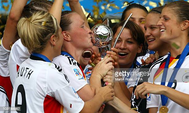 Marina Hegering of Germany kisses the trophy after winning the 2010 FIFA Women's World Cup Final match between Germany and Nigeria at the FIFA U20...