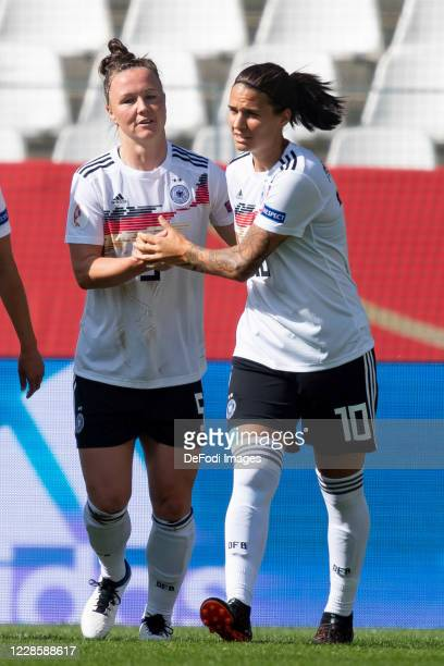 Marina Hegering of Germany with Dzsenifer Marozsan of Germany celebrates after scoring his team's first goal during the UEFA Women's EURO 2022...