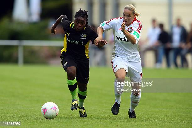 Marina Hegering of Leverkusen challenges Nothando Vilakazi of South Africa during the women's friendly match between South Africa and Bayer...