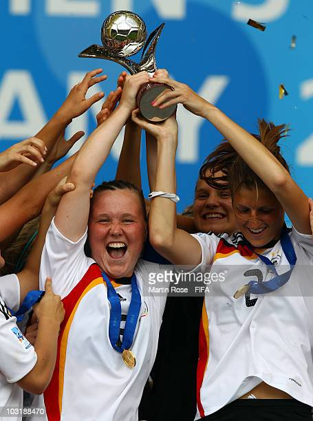 Marina Hegering team captain of Germany lifts the trophy after the 2010 FIFA Women's World Cup Final match between Germany and Nigeria at the FIFA...